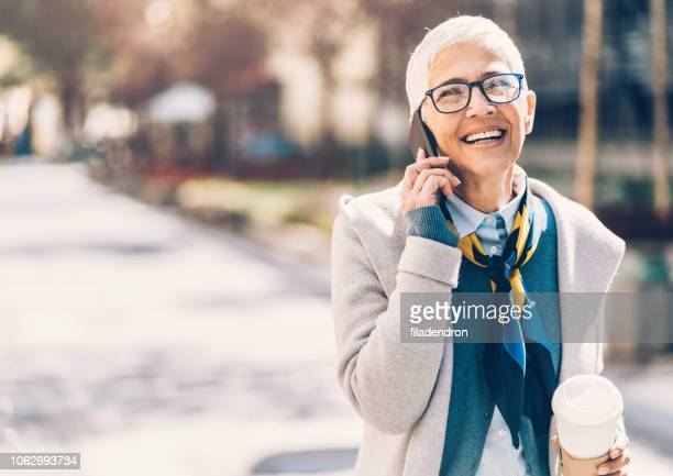 portrait mature business woman talking phone