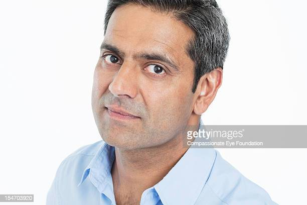 "portrait of mature businessman, close up - ""compassionate eye"" stockfoto's en -beelden"