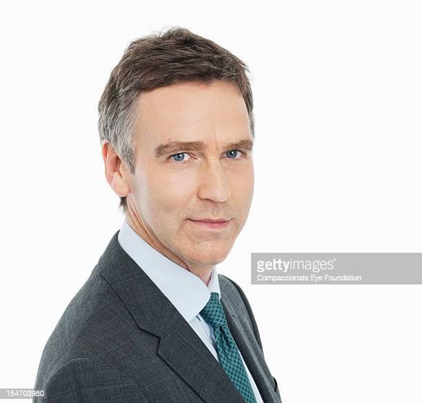 """portrait of mature businessman, close up - """"compassionate eye"""" foto e immagini stock"""