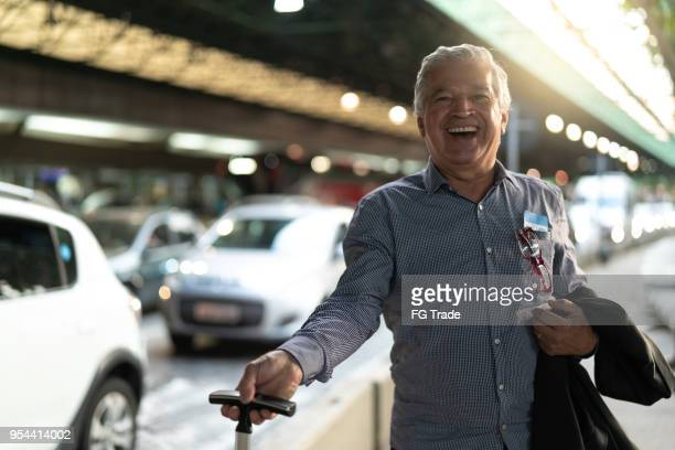 Portrait of Mature Businessman Going to Business Travel