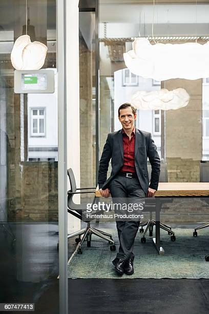 portrait of mature businessman in modern office - vanguardians stock pictures, royalty-free photos & images