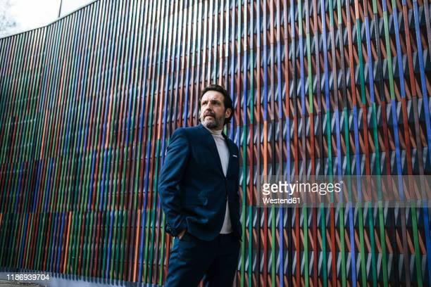 portrait of mature businessman looking at distance - 55 59 jahre stock-fotos und bilder