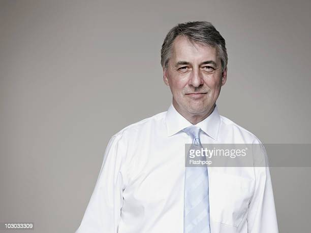portrait of mature businessman - shirt and tie stock pictures, royalty-free photos & images