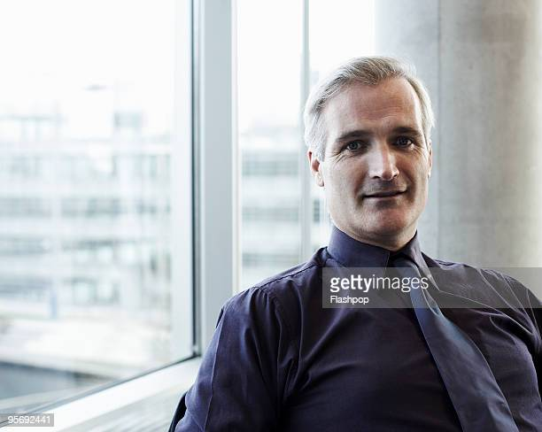 portrait of mature businessman - formal businesswear stock pictures, royalty-free photos & images