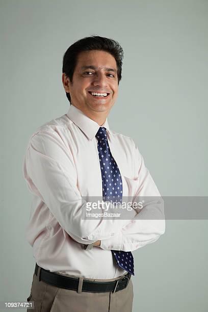 Portrait of mature businessman, studio shot