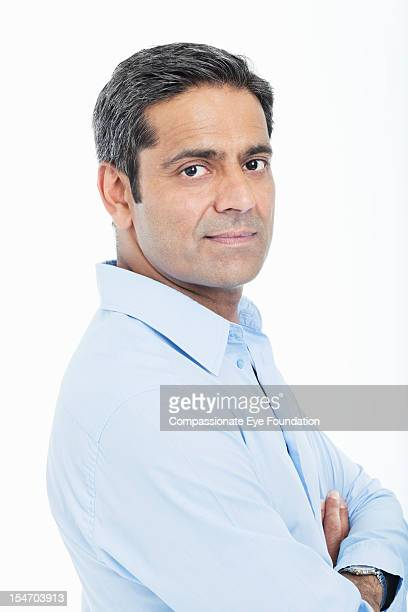 Portrait of mature businessman with arms folded