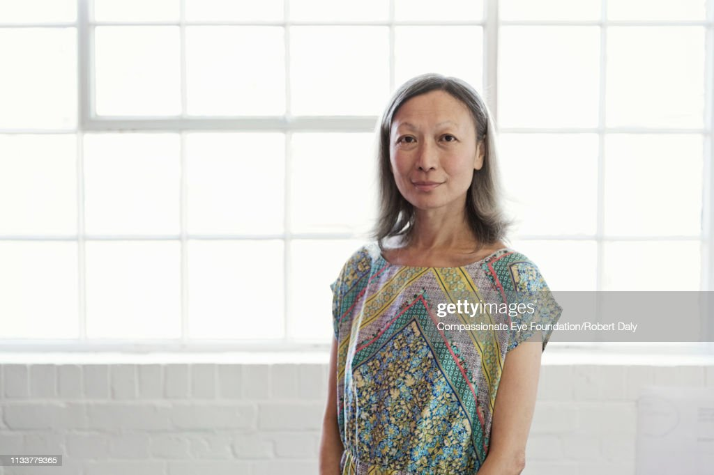 Portrait of mature businesswoman in office : Stock Photo