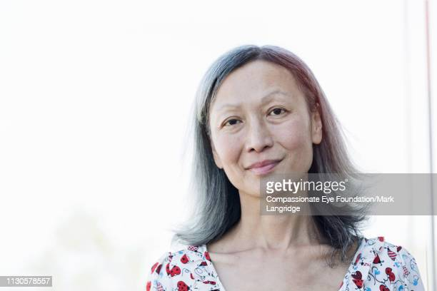 portrait of mature businesswoman - back lit stock pictures, royalty-free photos & images