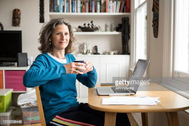portrait of mature businesswoman working  at home - mature adult stock pictures, royalty-free photos & images