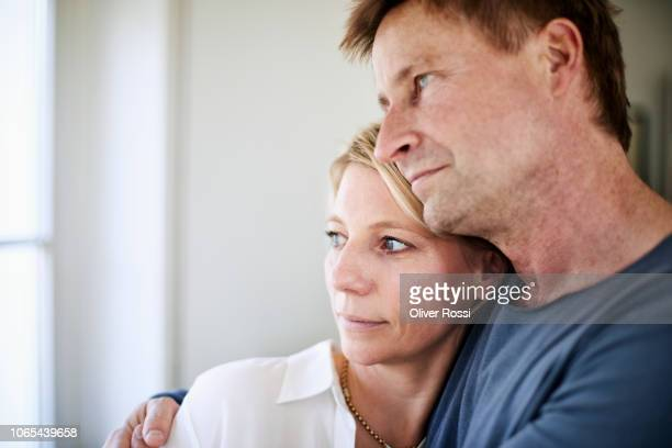 portrait of mature couple embracing - 40 49 years stock pictures, royalty-free photos & images