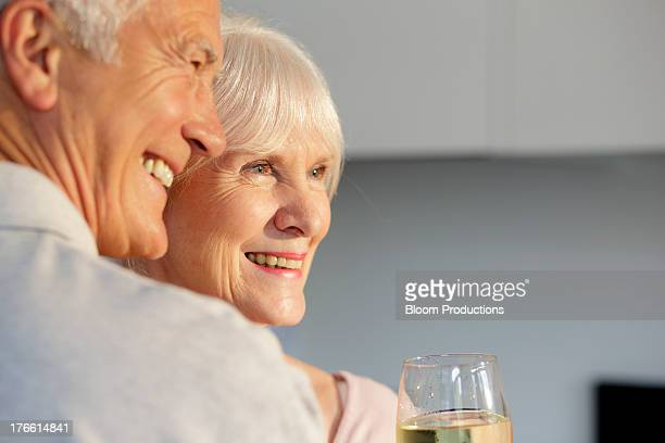 portrait of mature couple having a glass of wine - anniversary stock pictures, royalty-free photos & images