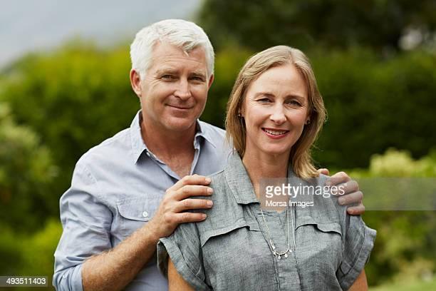 Portrait of mature couple in park