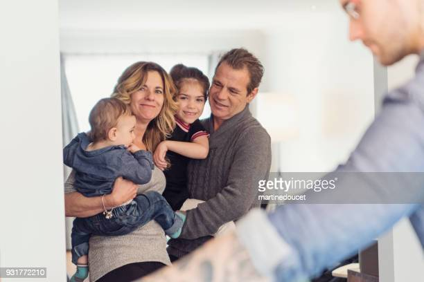 """portrait of mature couple of grandparents with grandchildren. - """"martine doucet"""" or martinedoucet stock pictures, royalty-free photos & images"""