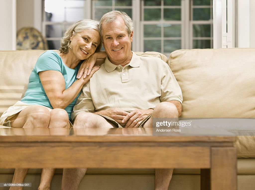 Portrait of mature Couple sitting on couch : Foto stock