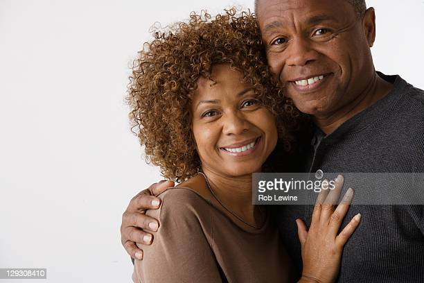 Portrait of mature couple, studio shot