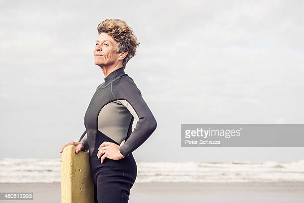 Portrait of mature female bodyboarder, Devon, UK