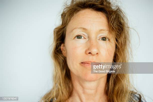 portrait of mature female on white backgroud - serious stock pictures, royalty-free photos & images