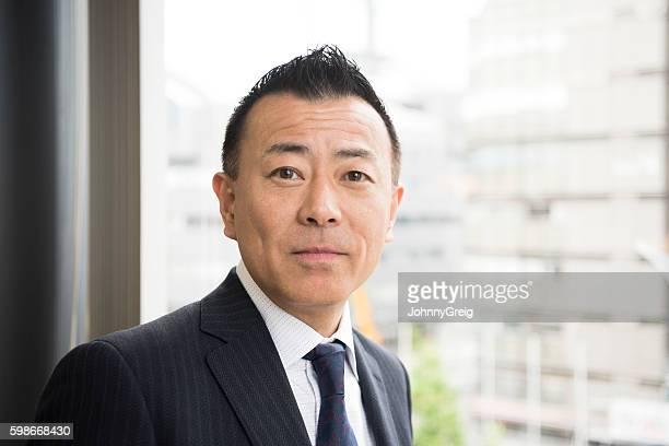 Portrait of mature Japanese businessman