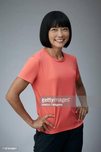 portrait of mature japanese woman - 女性 ストックフォトと画像
