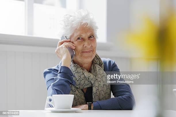 Portrait of mature lady using a smart phone