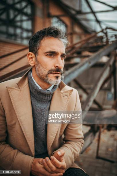 portrait of mature latin man. - neckline stock pictures, royalty-free photos & images