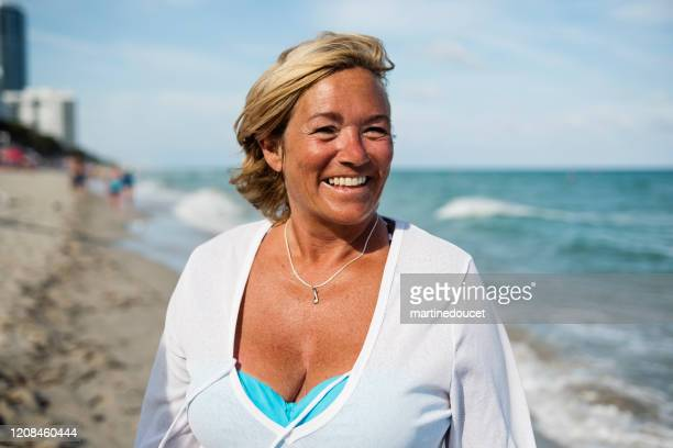 """portrait of mature lgbtq woman on the beach. - """"martine doucet"""" or martinedoucet stock pictures, royalty-free photos & images"""