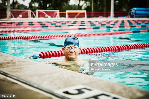 Portrait of mature male swimmer in outdoor pool during workout