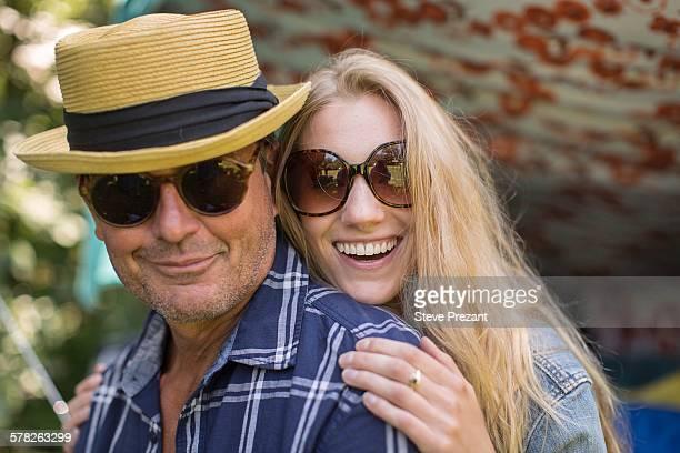 Portrait of mature man and girlfriend wearing sunglasses