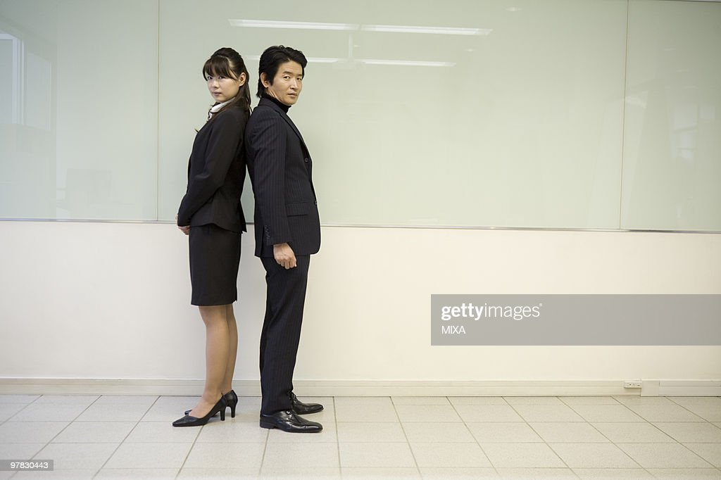 Portrait Of Mature Man And Young Woman High-Res Stock