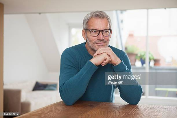 portrait of mature man at home - long sleeved stock photos and pictures