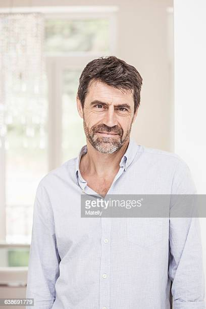 Portrait of mature man at home