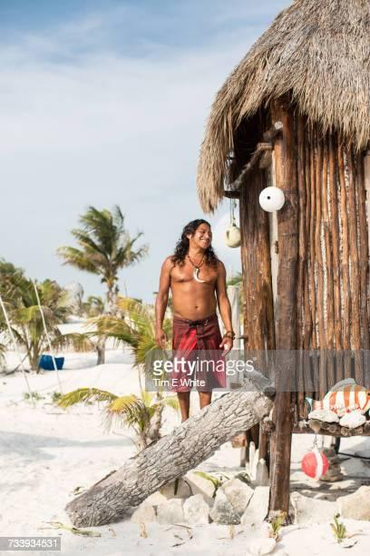 Portrait of mature man beside beach hut, Tulum, Mexico