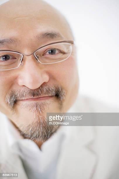 Portrait of Mature man, close up, studio shot
