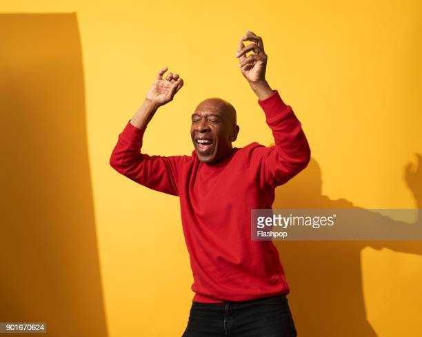 portrait of mature man dancing and having fun - fun photos et images de collection
