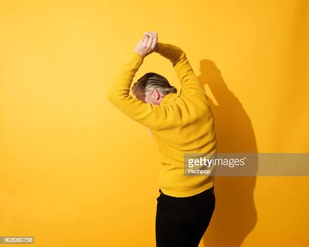 Portrait of mature man dancing and having fun