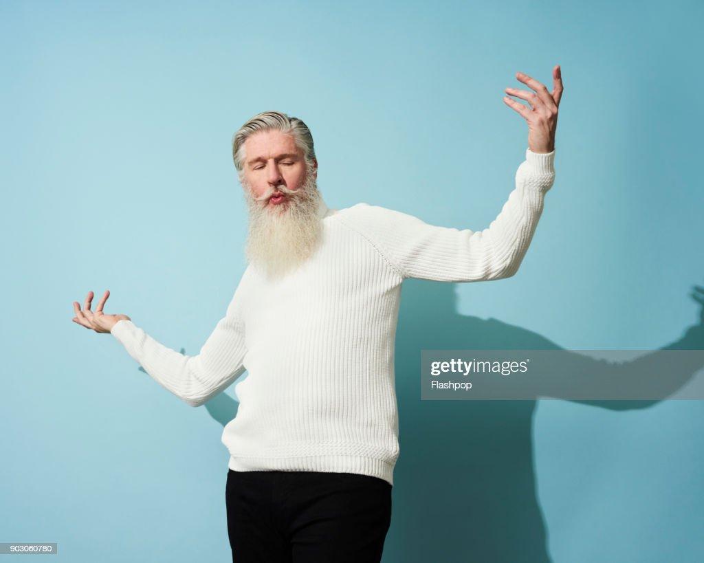 Portrait of mature man dancing and having fun : Stock Photo