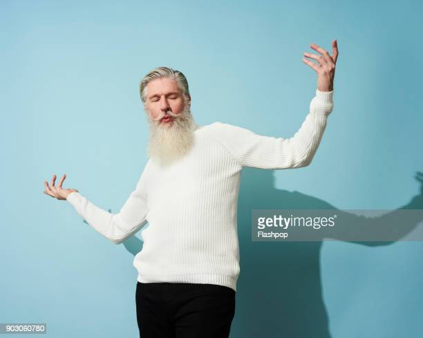 portrait of mature man dancing and having fun - sweater stock pictures, royalty-free photos & images