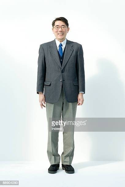 Portrait of mature man, full length, smiling