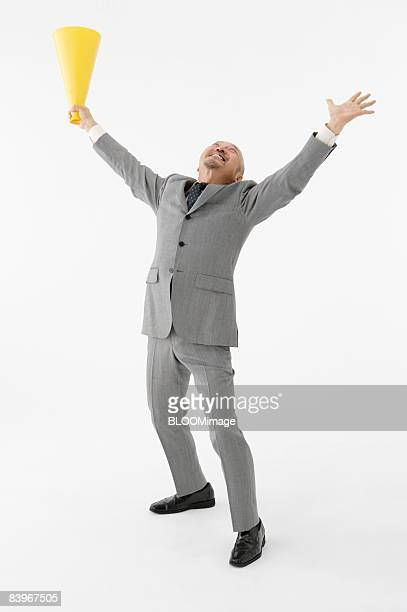 Portrait of Mature man holding megaphone