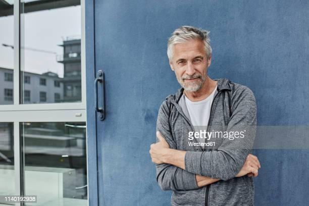 portrait of mature man in front of gym - white pants fotografías e imágenes de stock
