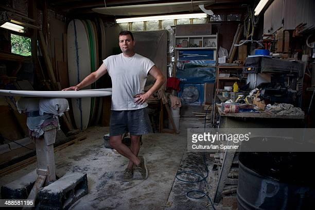 Portrait of mature man in his surfboard workshop