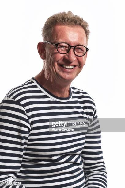 portrait of mature man in studio - ボーダーシャツ ストックフォトと画像