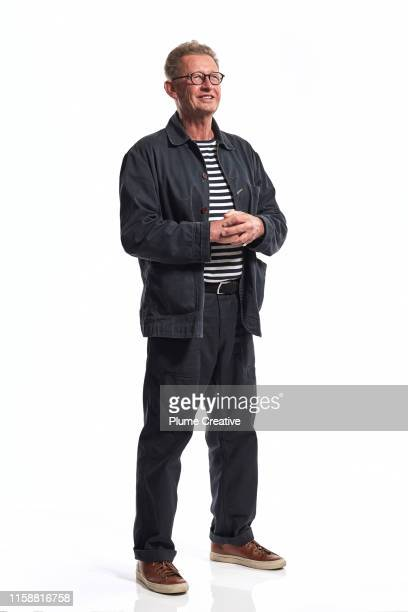portrait of mature man in studio - staan stockfoto's en -beelden