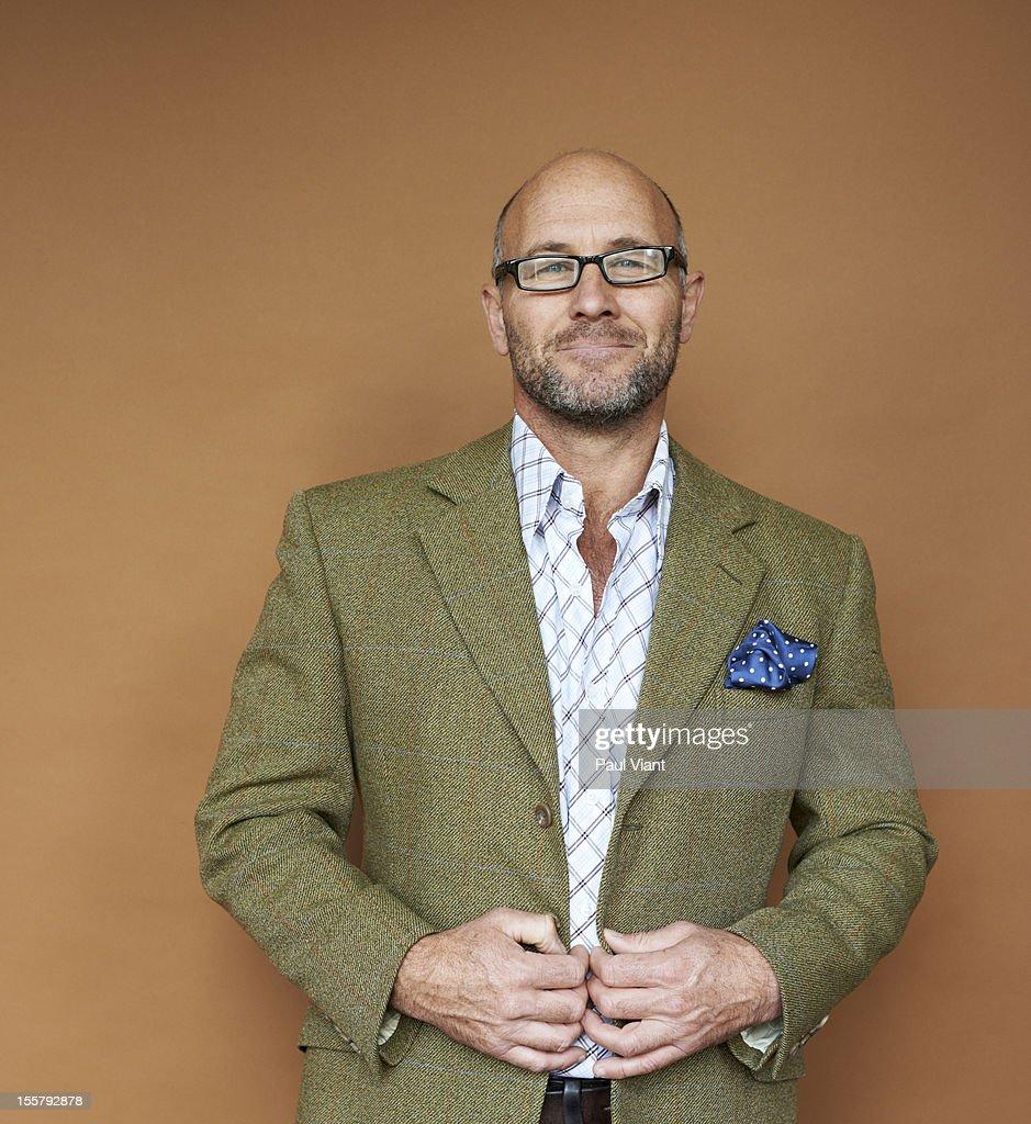 portrait of mature man in tweed jacket : Stock-Foto