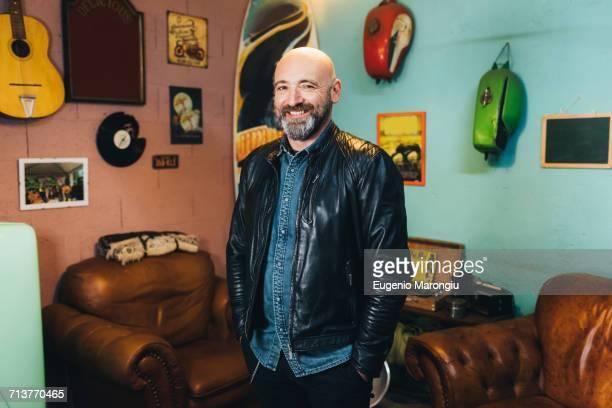 Portrait of mature man, indoors, smiling