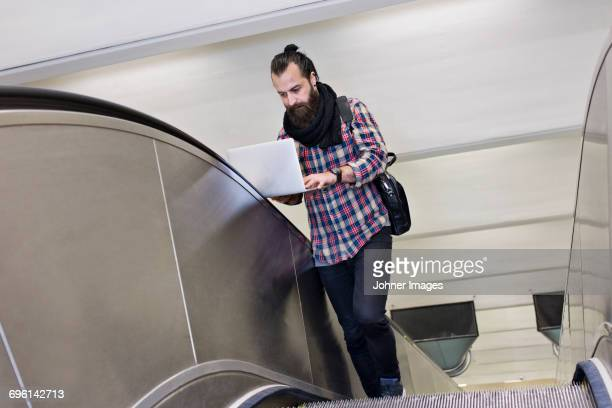 Portrait of mature man on escalator