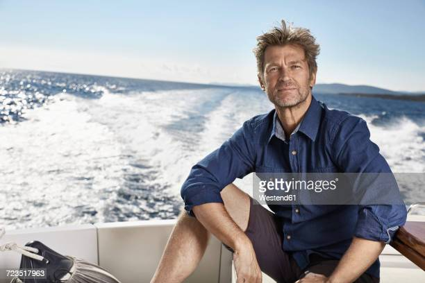 Portrait of mature man on his motor yacht