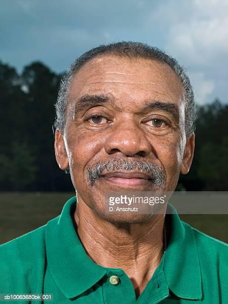 Portrait of mature man outdoors, close-up