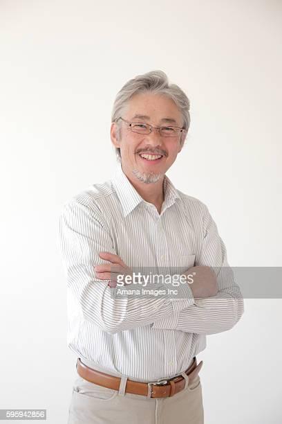portrait of mature man - 60代 ストックフォトと画像