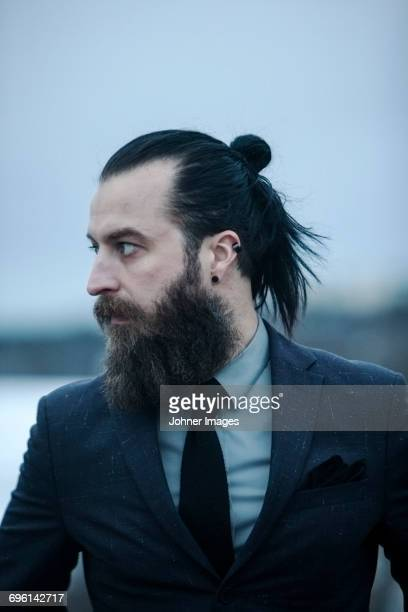 portrait of mature man - long hair stock pictures, royalty-free photos & images